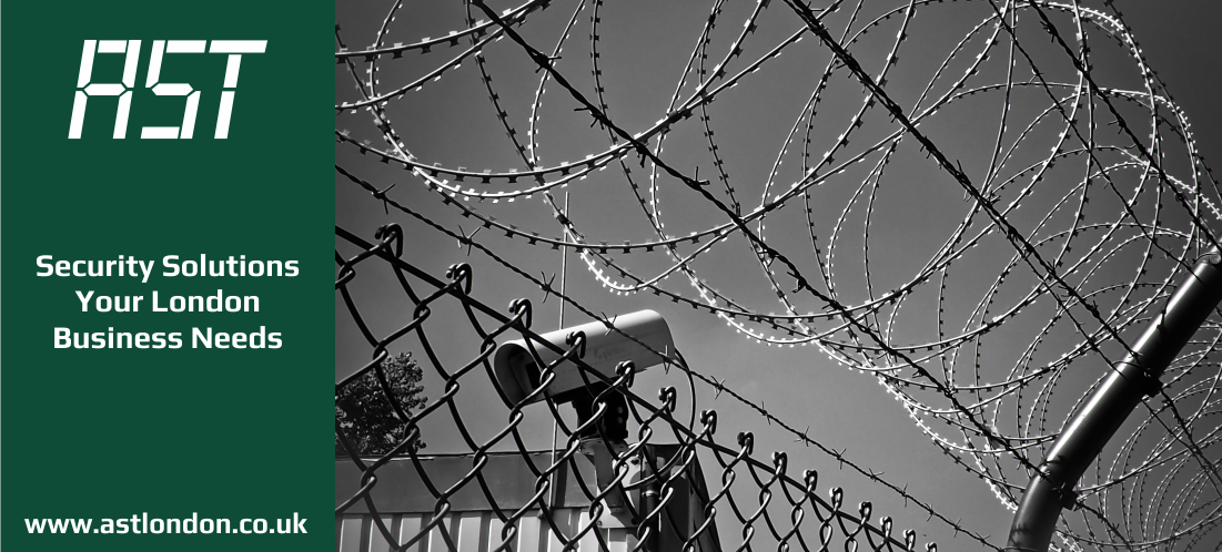 barbed wire fence with cctv camera